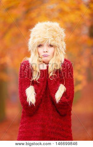 Pretty Fashion Woman In Winter Hat Feeling Cold.