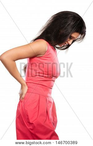 Mixed race woman suffering from backache back pain. Young girl isolated on white.