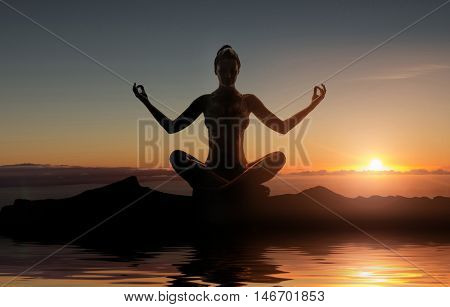 Silhouette of young woman meditating