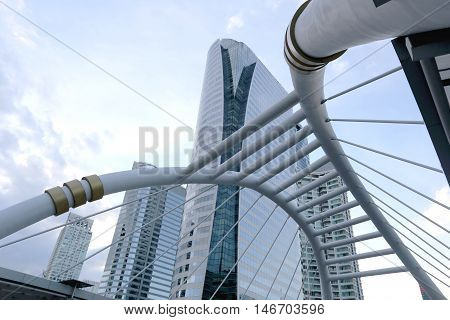 Skywalk of architecture bridge downtown in Bangkok for passenger to transit between BTS and MRT train at Sathorn road Thailand.