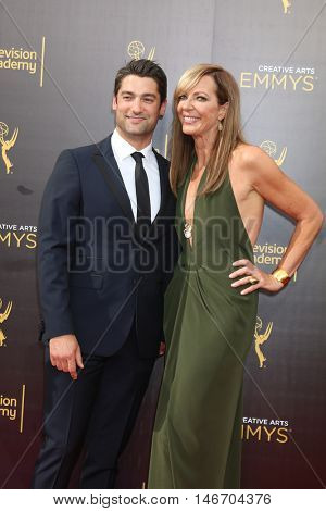LOS ANGELES - SEP 10:  Philip Joncas, Allison Janney at the 2016 Creative Arts Emmy Awards - Day 1 - Arrivals at the Microsoft Theater on September 10, 2016 in Los Angeles, CA