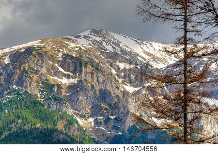 Spring mountain landscape. Beautiful snowy mountain peaks in Western Tatra Poland.