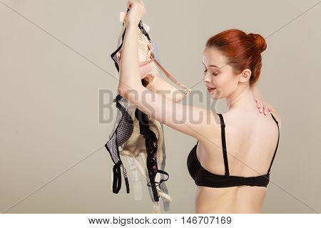 Woman Choosing Bras To Wear
