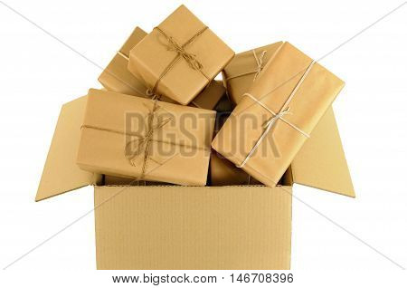 Cardboard box overflowing with lots of brown paper mail packages