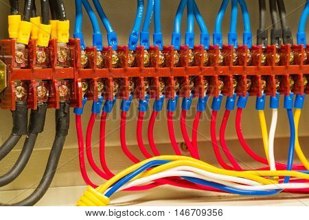 Front side showing colorful electrical wiring closeup.