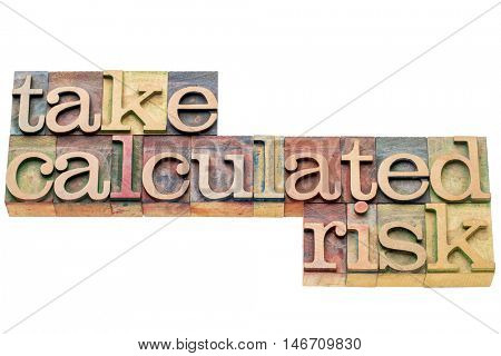 take calculated risk - isolated word abstract in letterpress wood type