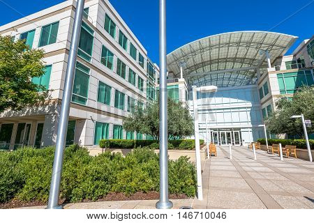 Cupertino, CA, USA - August 15, 2016: the Apple world headquarters at One Infinite Loop in California. Apple is a multinational corporation that produces technology devise.