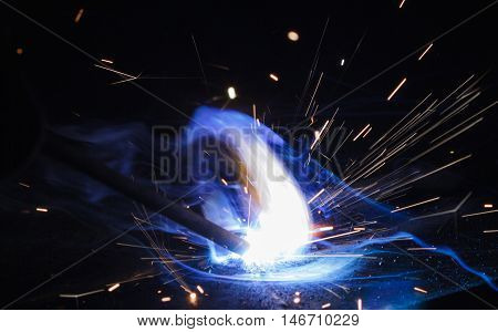 Arc welding and welding fumes of steel welding process, closeup view.