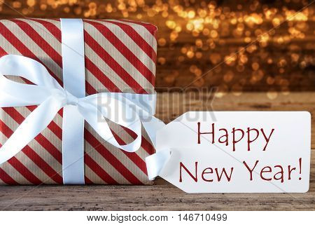 Macro Of Christmas Gift Or Present On Atmospheric Wooden Background. Card For Seasons Greetings, Best Wishes Or Congratulations. White Ribbon With Bow. English Text Happy New Year