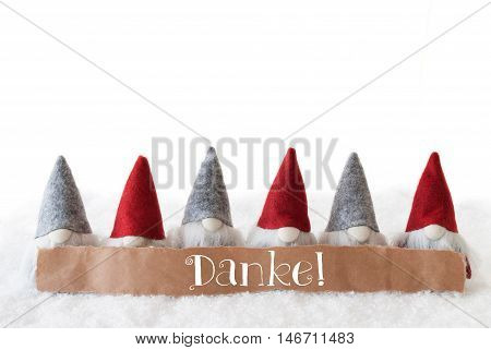Label With German Text Danke Means Thank You. Christmas Greeting Card With Gnomes. Isolated White Background With Snow.