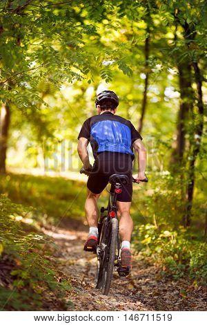 man riding mountain bike, concept - mountain bike