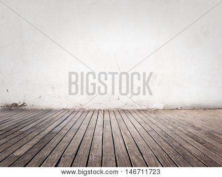 room with white wall and wood floor
