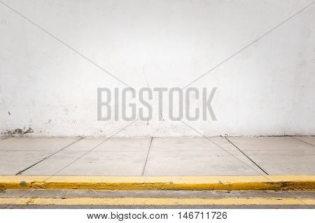 room with white wall and grey cement floor