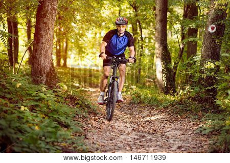 young cyclist on a mountain bike in forest