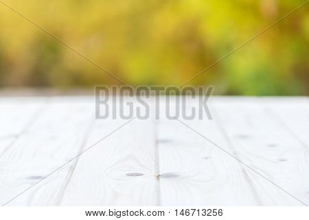 Wood table in nature with abstract blur background