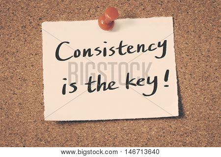 Consistency is the key note pin on the bulletin board