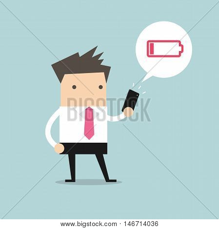 Businessman using smartphone with low battery alert
