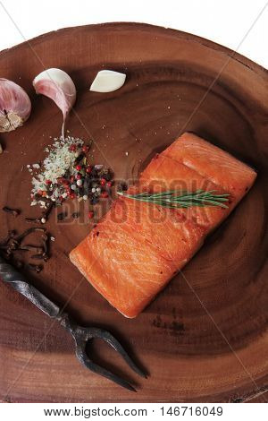 breakfast delicious portion fresh roast salmon fillet dry spices garlic rosemary wooden plate with black forged handmade fork healthy food diet cooking concept isolated on white background empty space