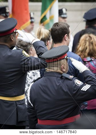 NEW YORK - SEPT 9 2016: Police officials from Toronto Canada salute at the NYPD Emerald Society Pipe and Drums 9/11 Memorial Commemoration Service marking the 15th anniversary of the terror attacks.