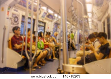 Blurred passenger in public train. Abstract blur defocused background effect. Background for travel transportation concept