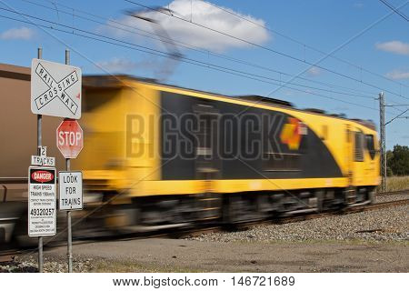 GLADSTONE, AUSTRALIA - September 2: An Aurizon coal train passes by a level crossing in the Gladstone region on Friday, 2nd September, 2016.