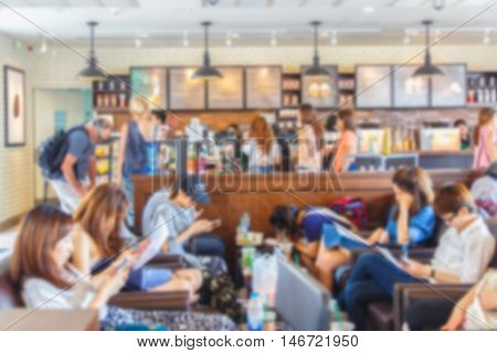 Blurred passenger in coffee shop. Abstract blur defocused background effect. Background for food and drink or relaxing in restaurant concept.