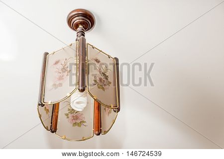 A Small Chandelier Hanging From The Ceiling