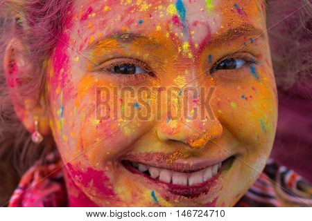Girl Having Fun At The Festival Of Colors