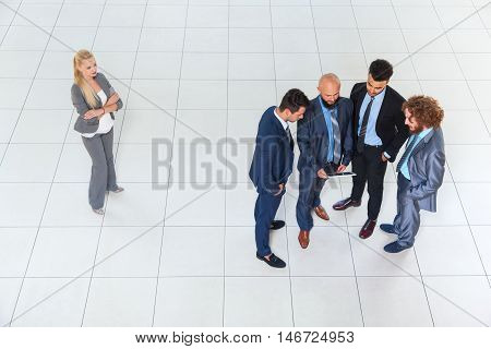Business Men Group Discussion Meeting Using Tablet Computer, Businessmen Community Together, Businesswoman Stand Aside Concept Gender Women Rights Discrimination Top Angle View Modern Office