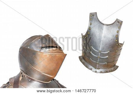 An antique European armor with helmet and breastplate isolated against white background.