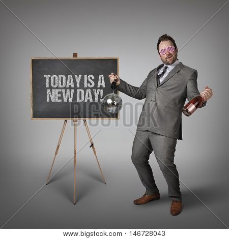 Today a new day text on  blackboard with drunk businessman