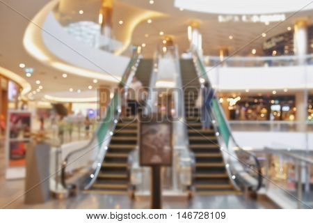 Blurred escalator in department store for background