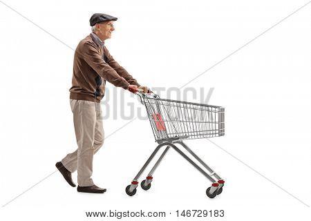 Elderly man pushing a shopping cart isolated on white background