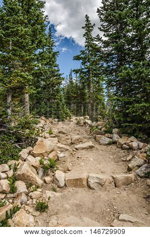 Hiking trail made with dirt and rocks in the Uinta Mountains in Utah
