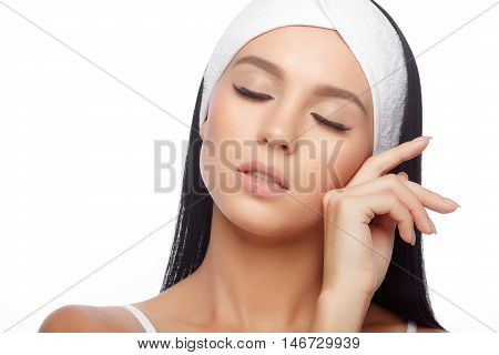 Young Woman with Closed Eyes in Hairband Touching her Face with a Perfectly Clean Skin. Beautiful Woman Cares for the Skin Face. Skin Care, Cosmetics and Makeup Concept.
