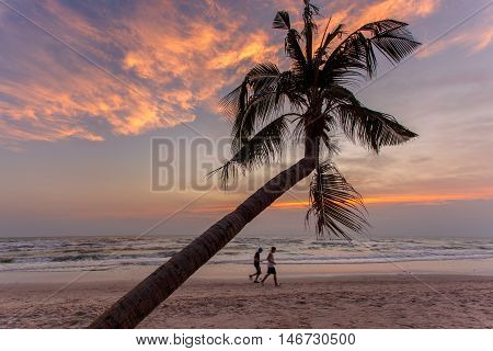 Two person running on the beach in morning time at Hua Hin beach Thailand (Subject movement shooting)