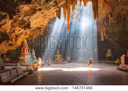 Female photographer take a photo at Khao Luang cave in Phetchaburi Thailand