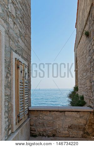 Beautiful ancient stone buildings in Istria, Croatia with sea view