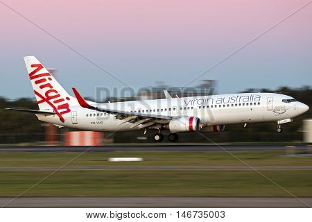 BRISBANE, AUSTRALIA - June 25: A Virgin Australia Boeing 737 jet lands in Brisbane on Saturday, 25th June, 2016.
