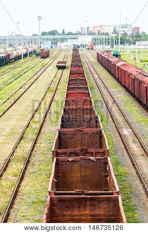 Old rusty empty freight cars standing at the station