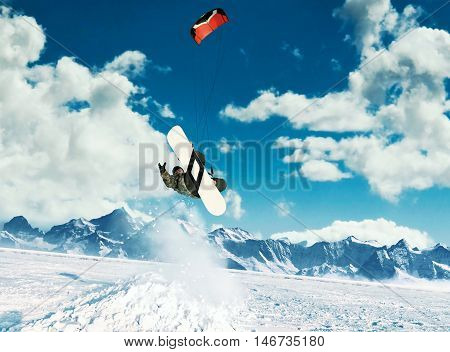 Young Men, Ride Snowboarding On Frozen Lake In The Mountains, In The Rays Of The Rising Sun, In Wint