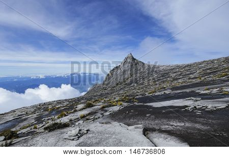 South Peak (3921m) of Mount Kinabalu Sabah Malaysia. Mount Kinabalu or Gunung Kinabalu is the 20th most prominent mountain in the world by topographic prominence.