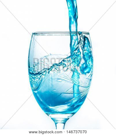 Blue water drop into a glass of water distribution . White background