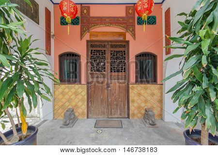 PHUKET THAILAND - SEPTEMBER 28 : Old building Chinese and Sino Portuguese style in Phuket on September 18 2014 in Phuket Thailand. Old building is a very famous tourist destination of Phuket.