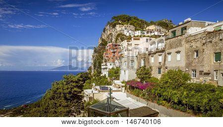 Capri town on Capri Island with Vesuvius volcano and Naples in the background Italy
