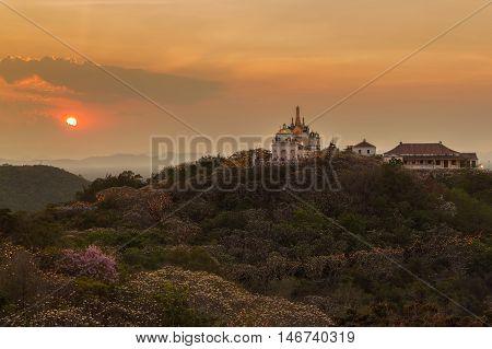 Beautiful big pagoda with Phra Nakhon Khiri on sunset time at Phetchaburi Province Thailand