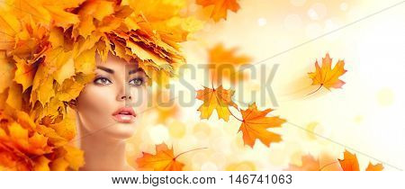 Autumn Woman, Fall. Beauty model girl with autumn bright leaves hairstyle. Beautiful Fashion female with Autumnal Make up and Hair style. Creative Autumn Makeup. Beautiful Face