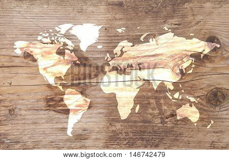 White world map on brown wooden background