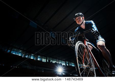 Athlete with a bicycle indoors