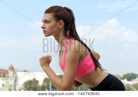 Side View Of A Girl Is Going Start Running